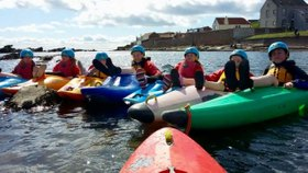 Photo of kayaking class on the water
